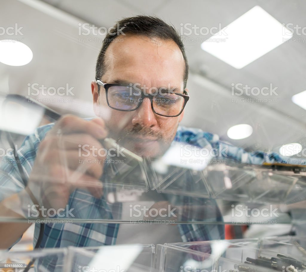 IT technician working at an electronics store stock photo