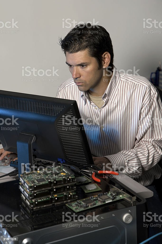 IT Technician  Working at Computer Terminal in Office royalty-free stock photo