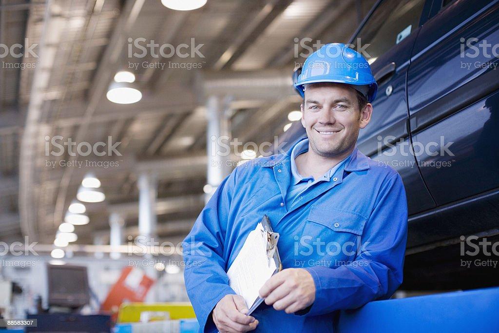 Technician working in auto shop stock photo