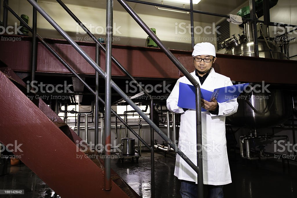 technician working in pharmaceutical factory royalty-free stock photo
