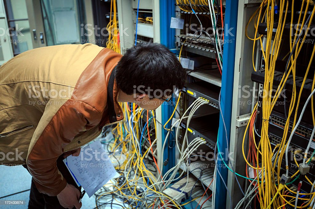 Technician working on a server room royalty-free stock photo