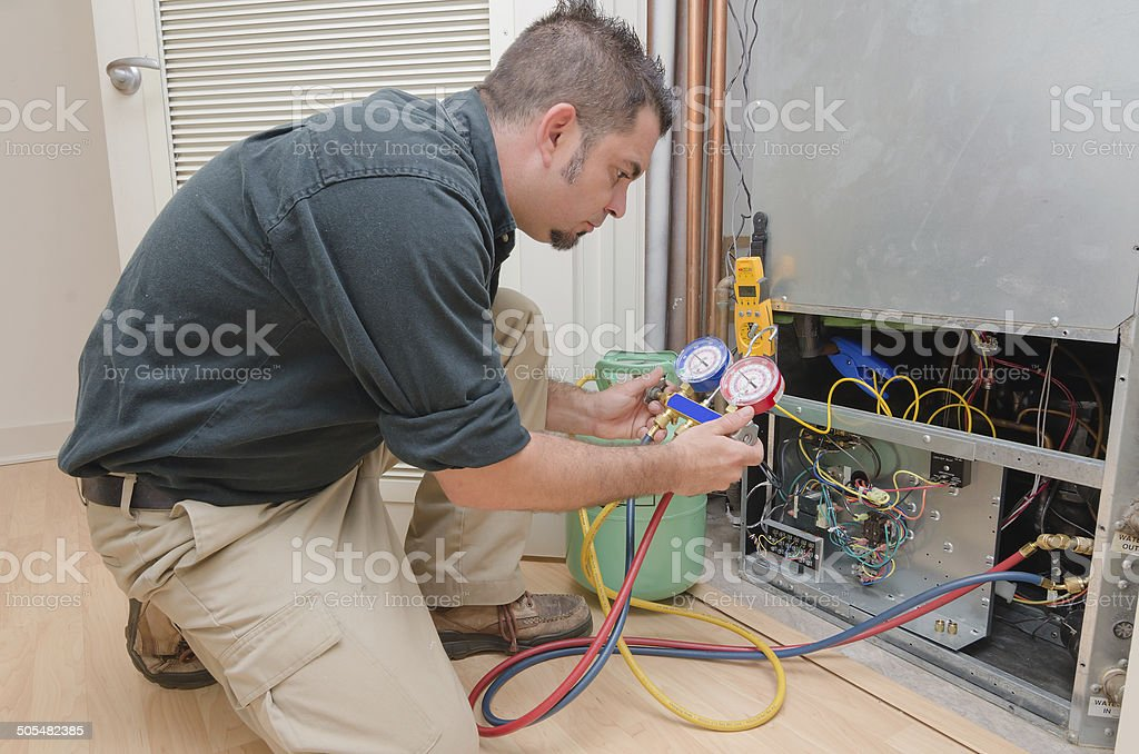 HVAC Technician Working stock photo