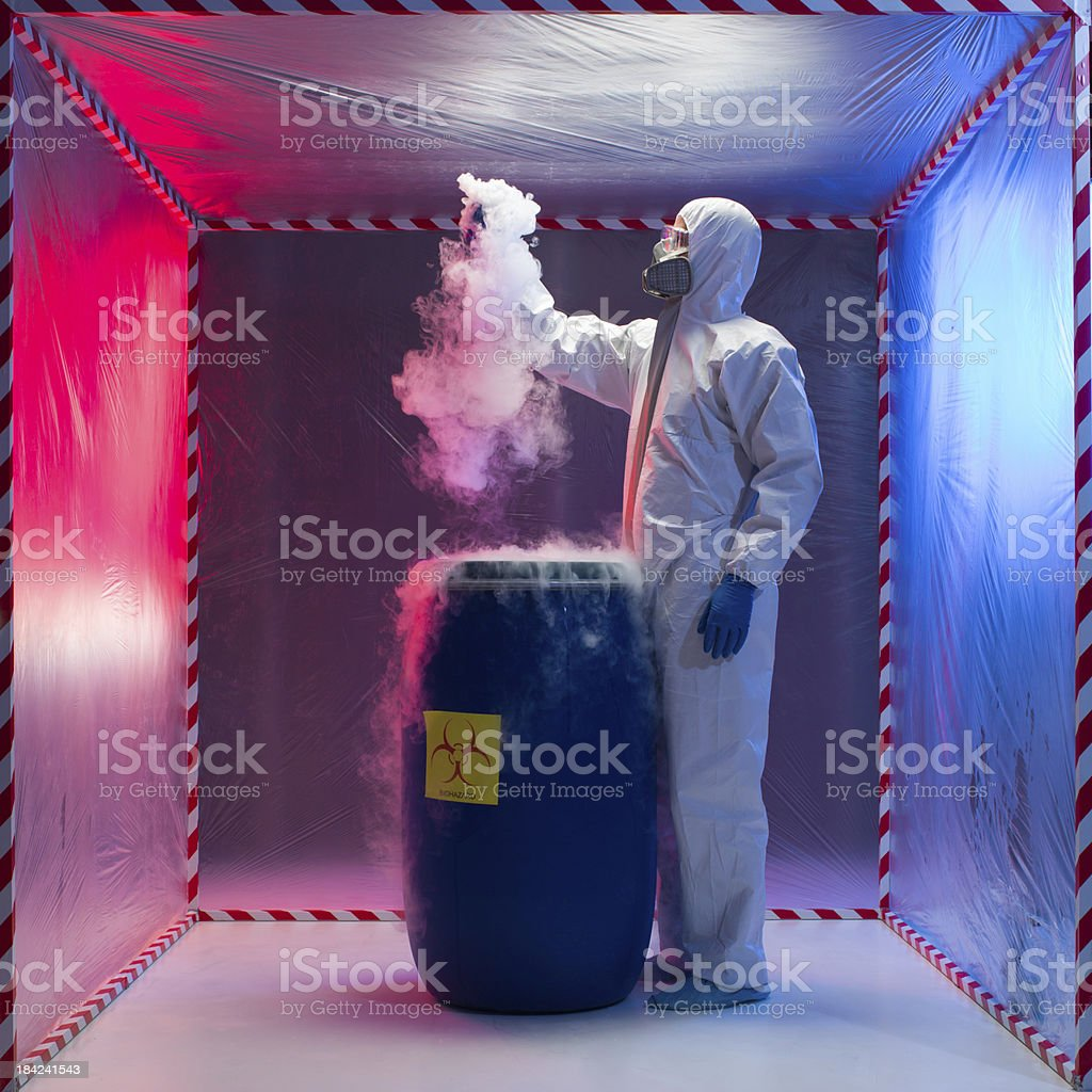 Technician working with a biohazardous sample royalty-free stock photo