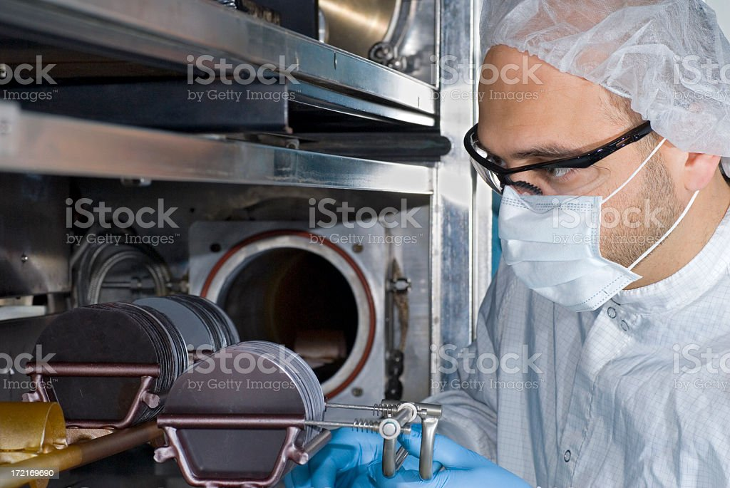 Technician Working with Silicon Wafers stock photo