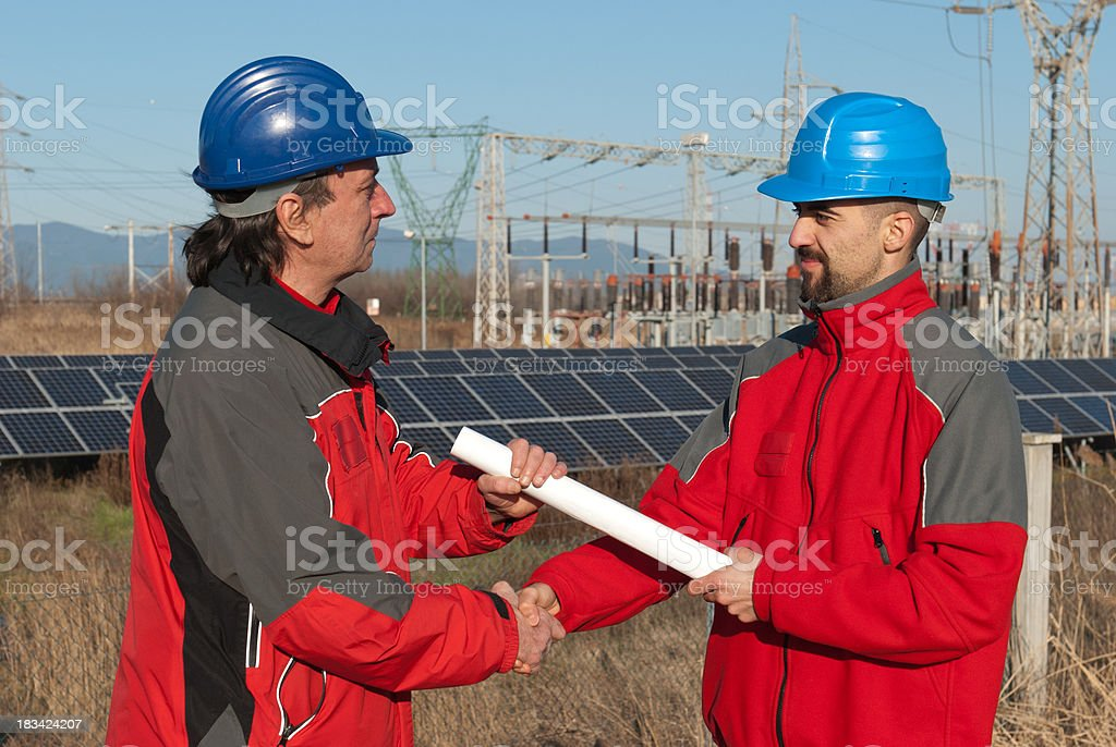 Technicians engineer hands sealing a deal royalty-free stock photo