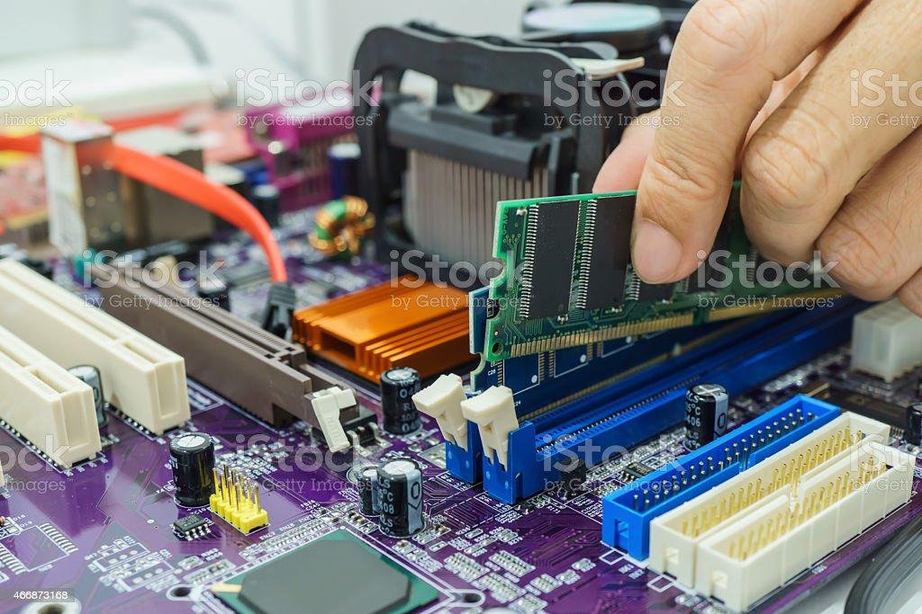 Technician's hands Installing RAM stock photo