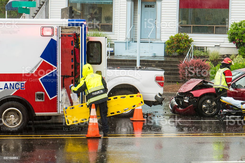 EMT technicians responding to traffic accident stock photo