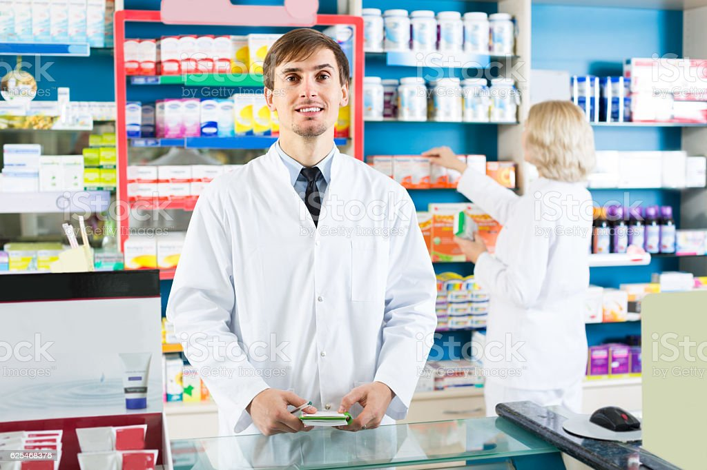 technicians working in chemist shop stock photo