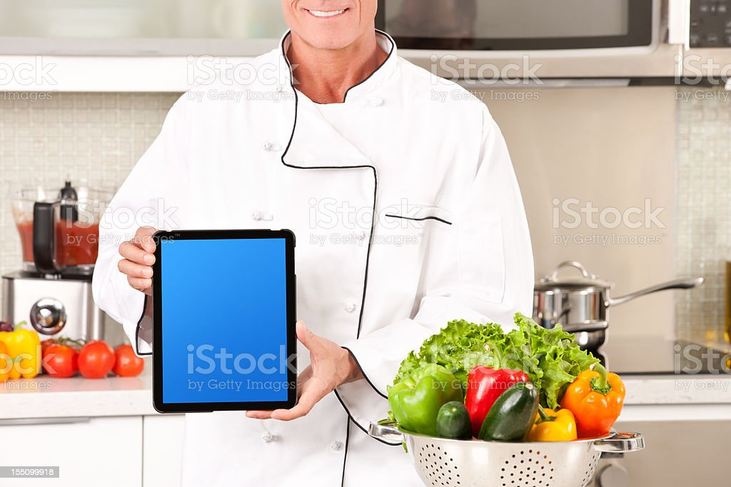 Technological Chef Showing Tablet PC royalty-free stock photo