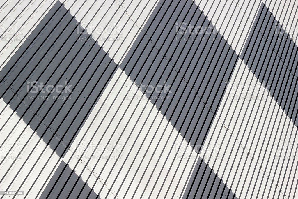 Technological corrugated metal wall with black and white square pattern stock photo