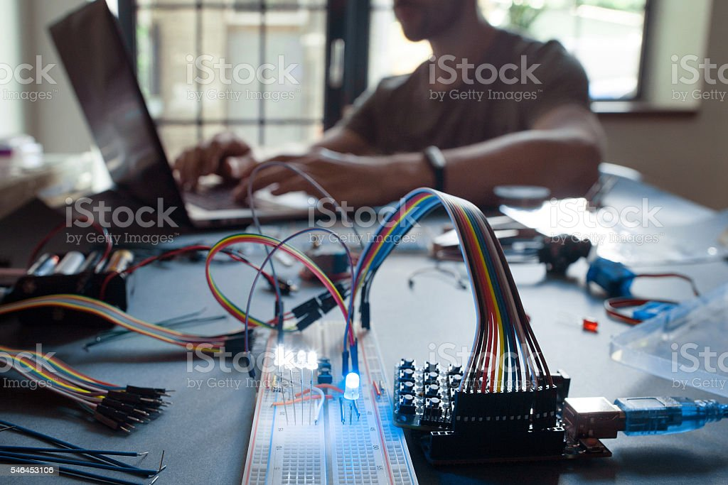 Technological education student studying on laptop stock photo