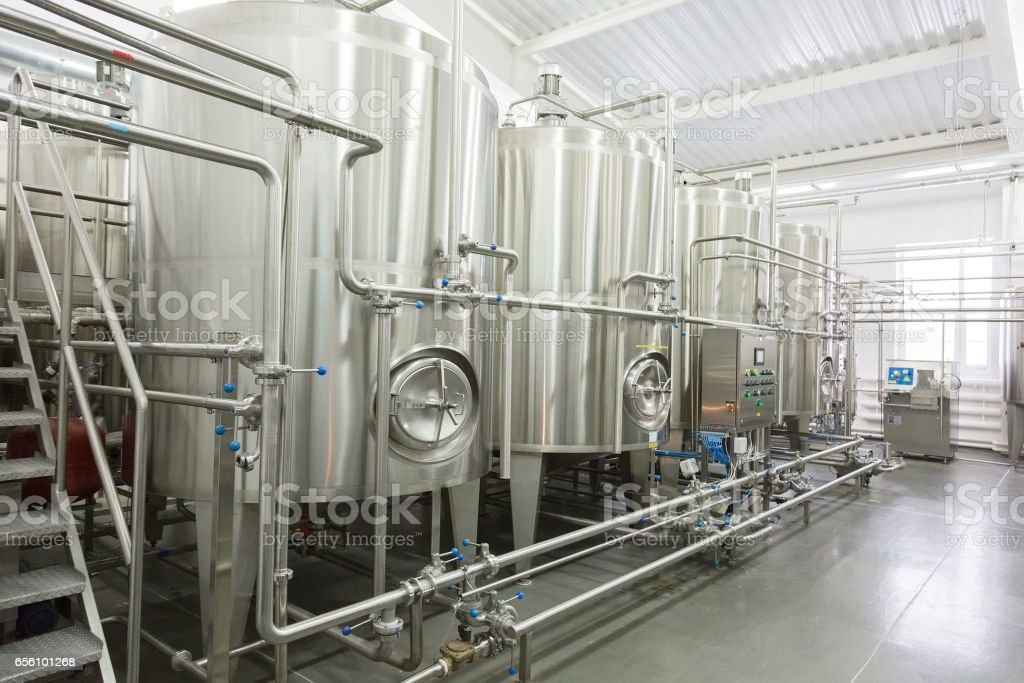 Technological equipment in the dairy plant stock photo