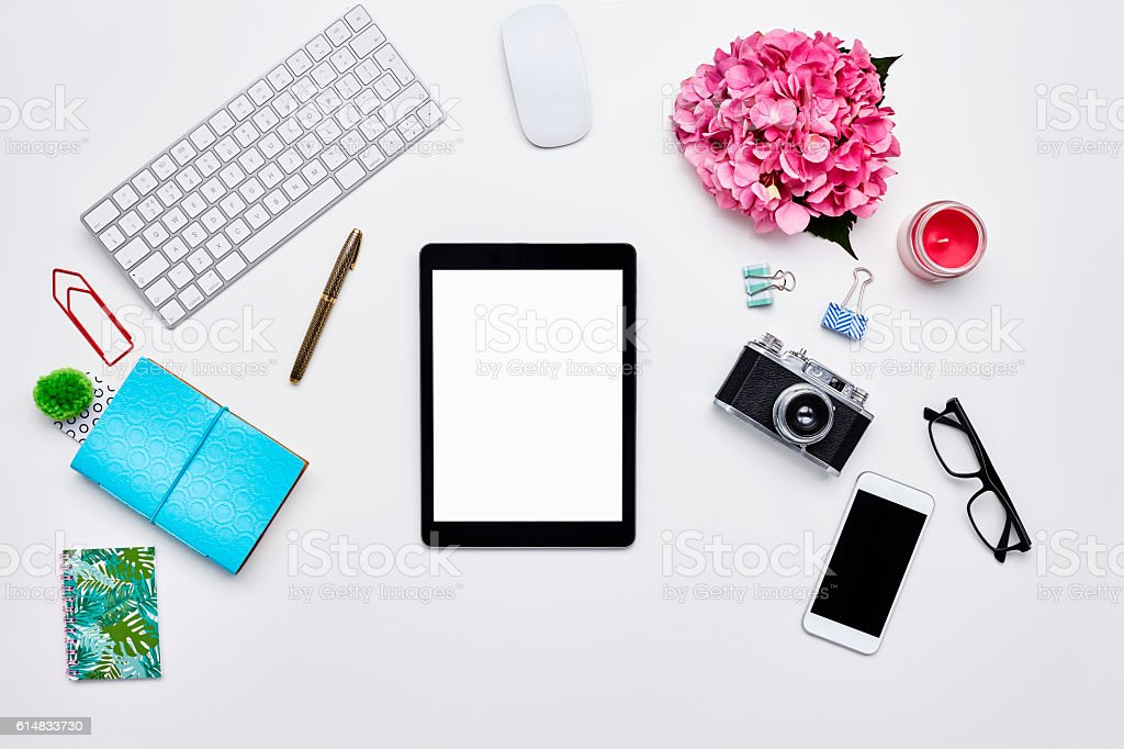 Technologies and office supplies on white background stock photo