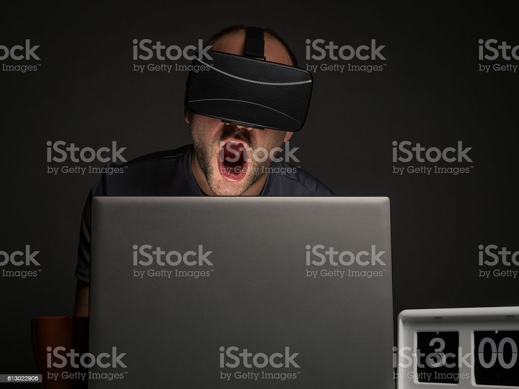 Technology addicted man with insomnia stock photo