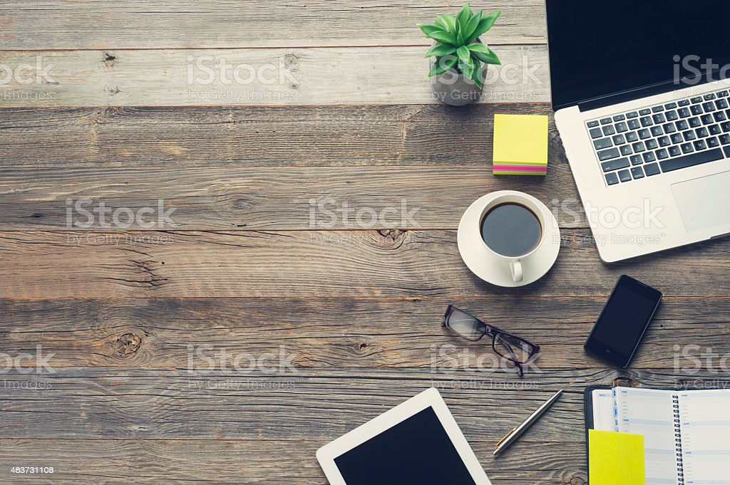 Technology and coffee on a wooden table. stock photo