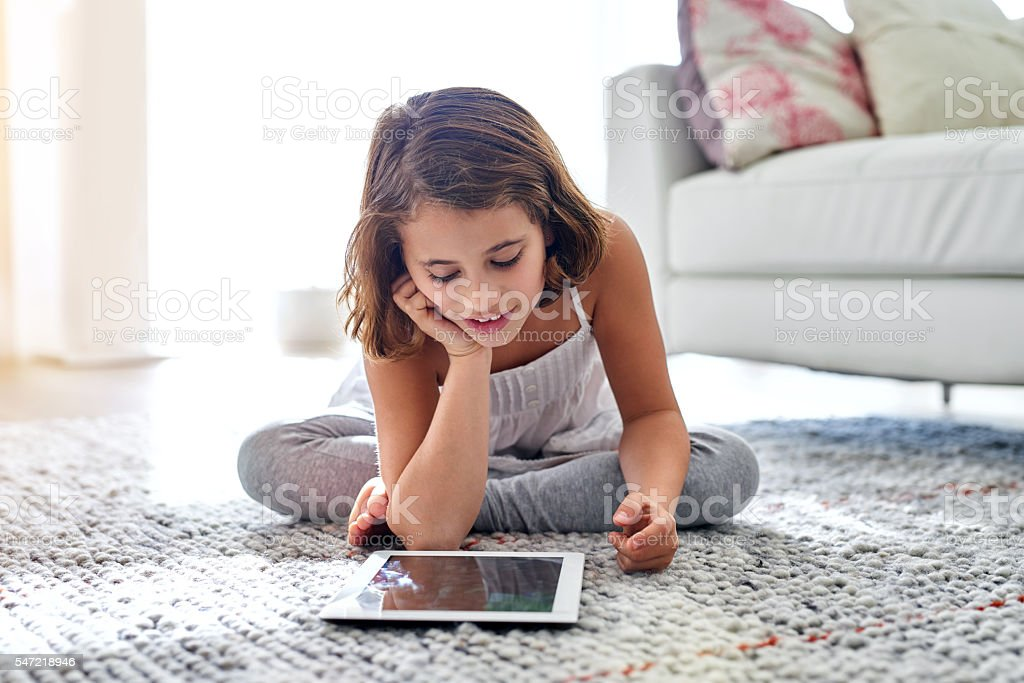 Technology at her fingertips stock photo