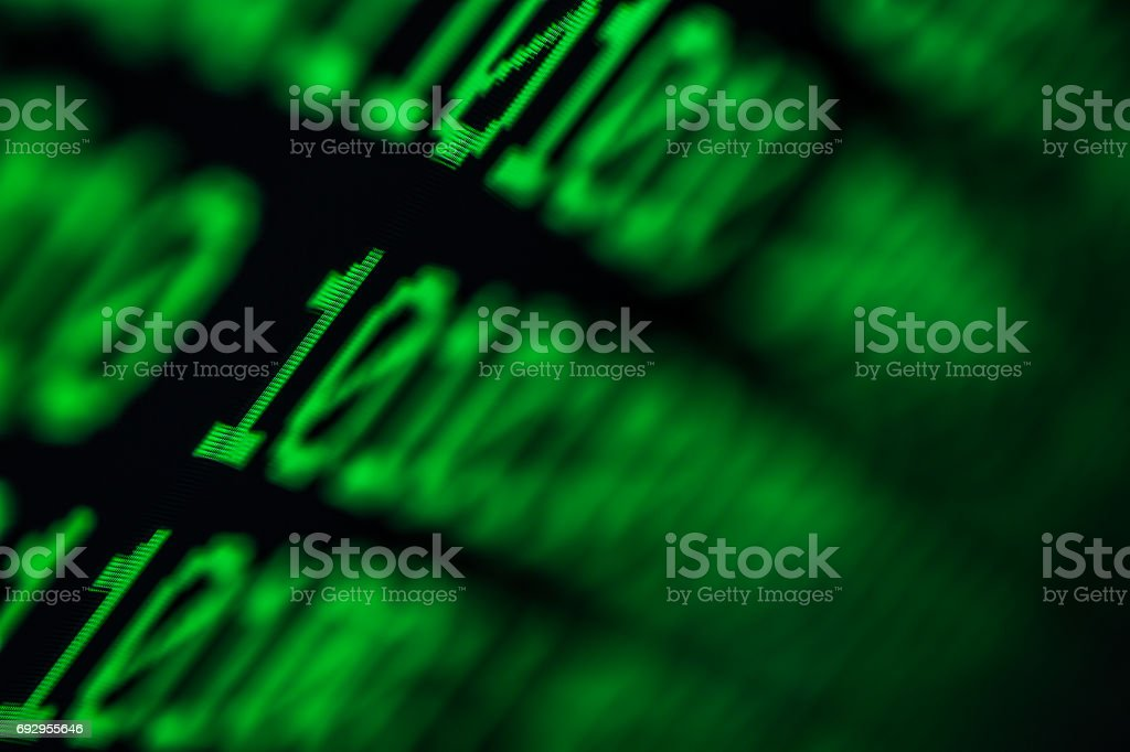 Technology background, close up on texture digital pixel is running primary code number with black background and selective focus. stock photo