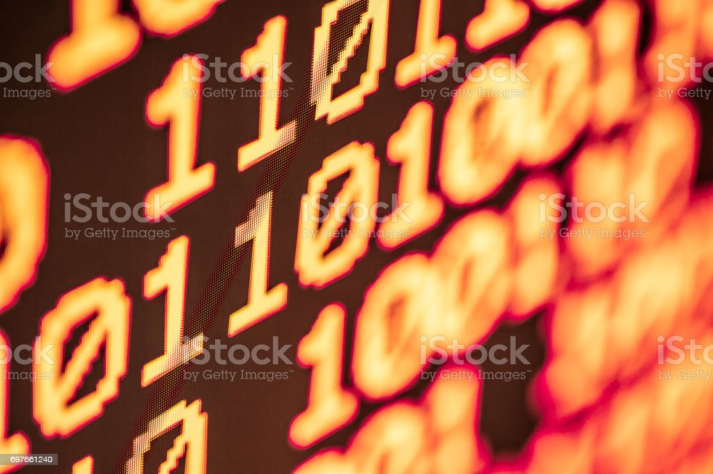 Technology background, close up on texture digital pixel is running prinary code number with black background and selective focus. stock photo