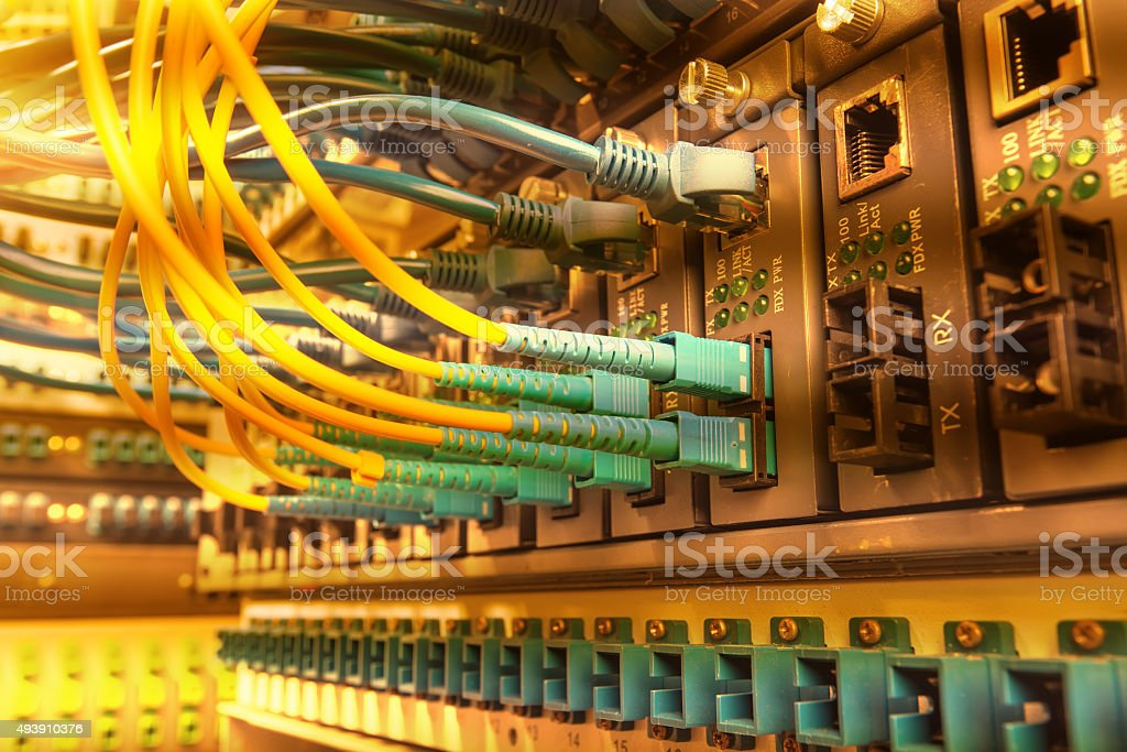 Technology center with fiber optic equipment stock photo