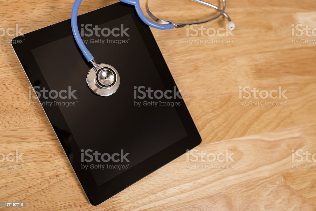 Technology: Check up for 'ill' digital tablet. Stethoscope. royalty-free stock photo