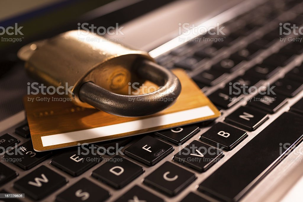 Technology: Computer with credit card and lock. Identity theft concept. stock photo