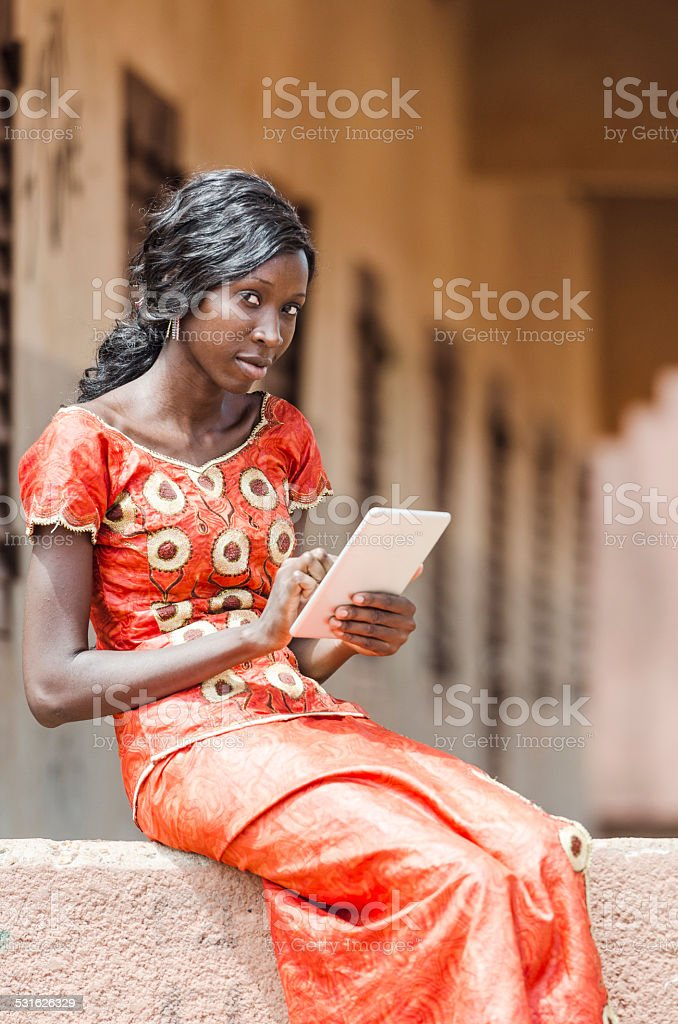 Technology for Africa Symbol: Modern Life African Ethnicity Woman Tablet stock photo