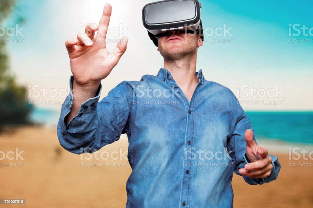 Technology, gaming, entertainment and people concept. Man wearing formal suit and virtual reality headset or 3d glasses, playing video game, gesturing with his hands and catching something stock photo