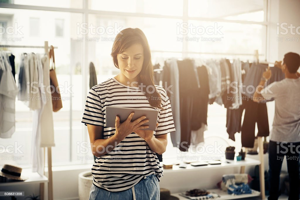 Technology helps her to keep up with the latest trends stock photo