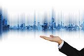 Technology hologram modern city on businessman hand, on white background
