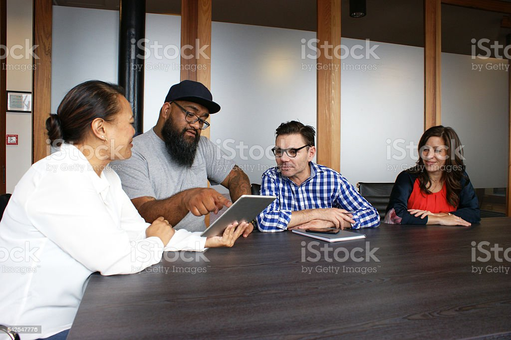 Technology in a business meeting stock photo