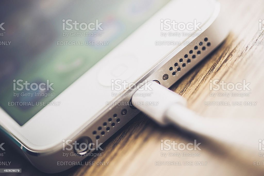 Technology: iPhone5 Showing Charging Ports and Charger stock photo