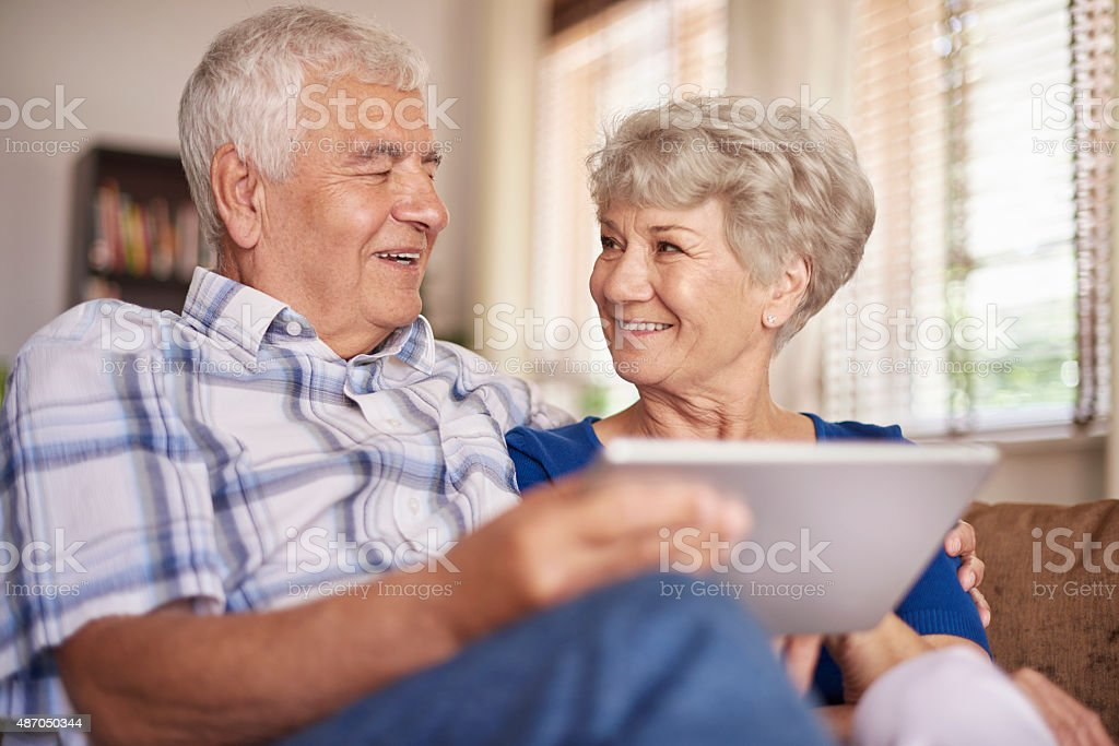 Technology is nothing difficult for this couple stock photo