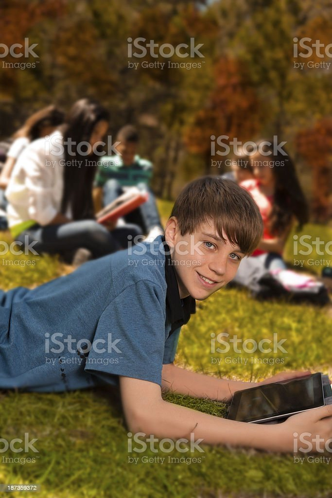 Technology:   Junior high student uses digital tablet to study. royalty-free stock photo