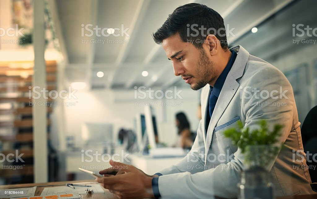 Technology keeps him in touch with the latest business trends stock photo