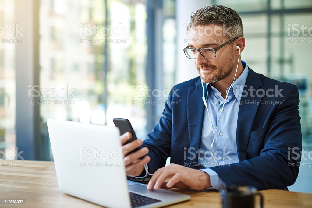 Technology keeps him the know stock photo