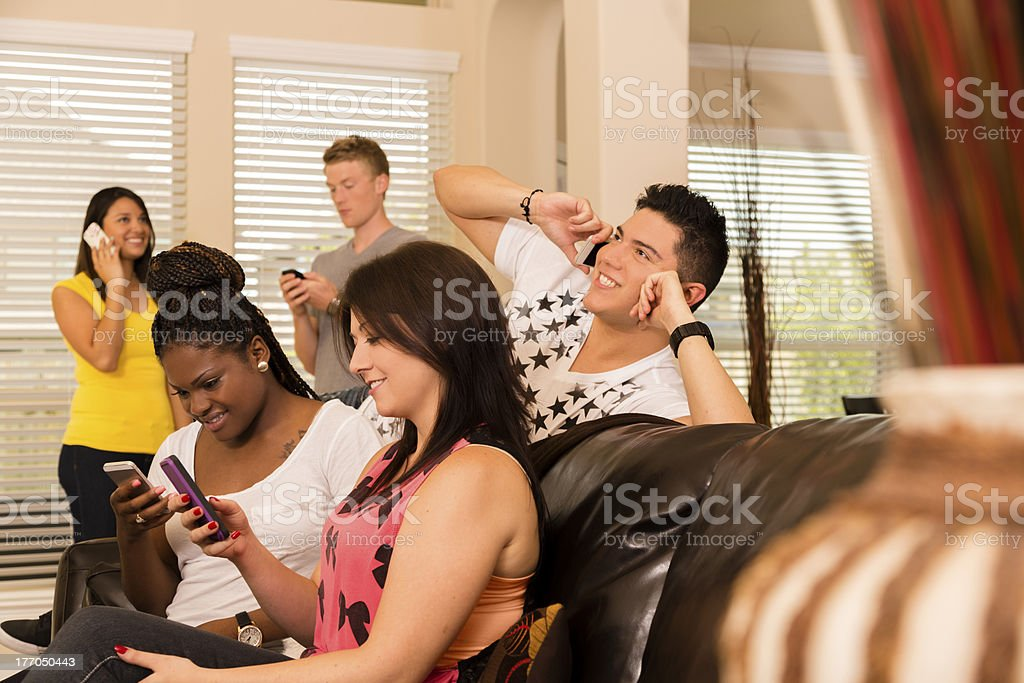Technology:  Multi-ethnic group of young adults all on cell phones. royalty-free stock photo