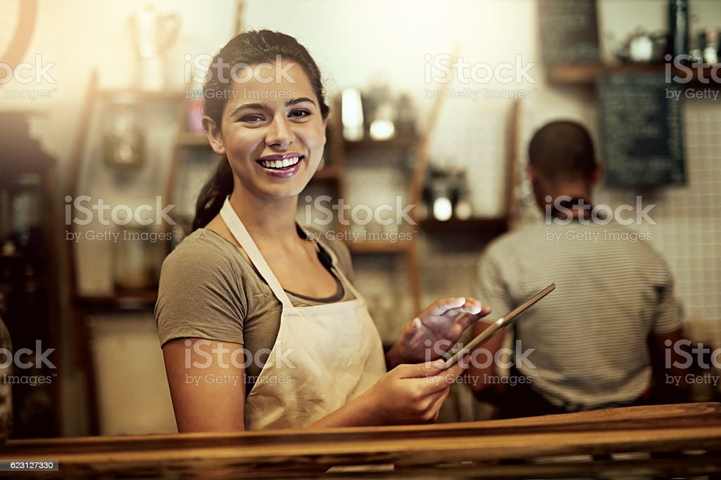 Technology plays an important role in successfully running my cafe stock photo