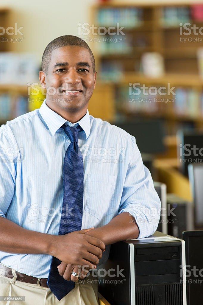 Technology teacher at STEM high school stock photo
