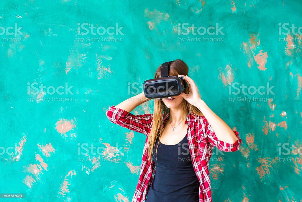 technology, VR, entertainment and people concept - happy young woman stock photo