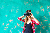 technology, VR, entertainment and people concept - happy young woman