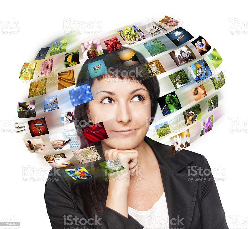 Technology woman has images around his head. stock photo