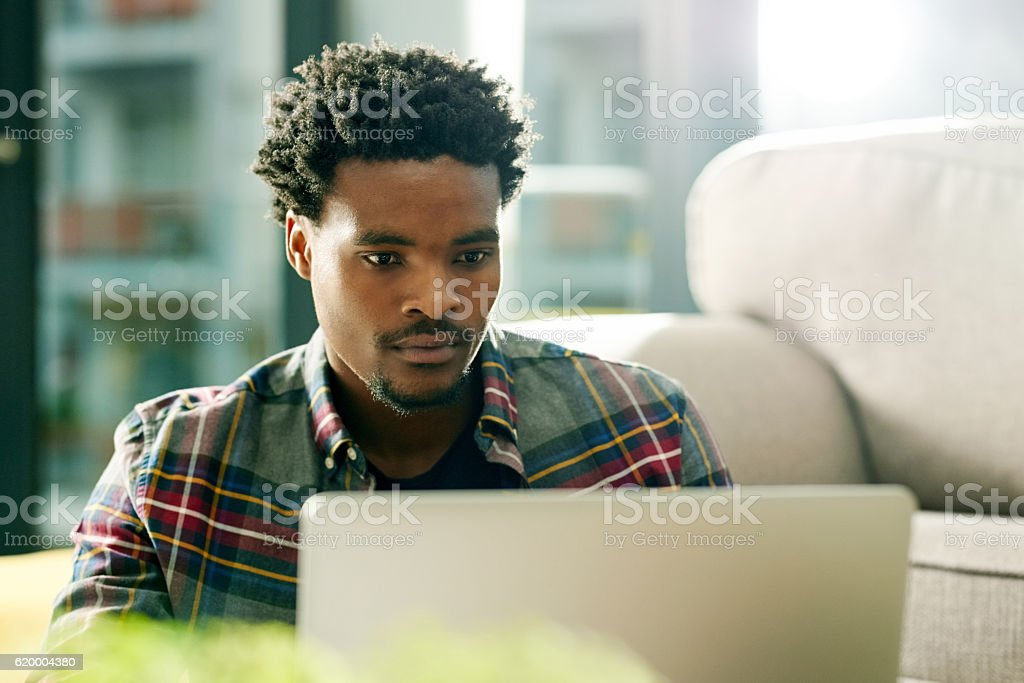 Technology's got his work and entertainment needs covered stock photo