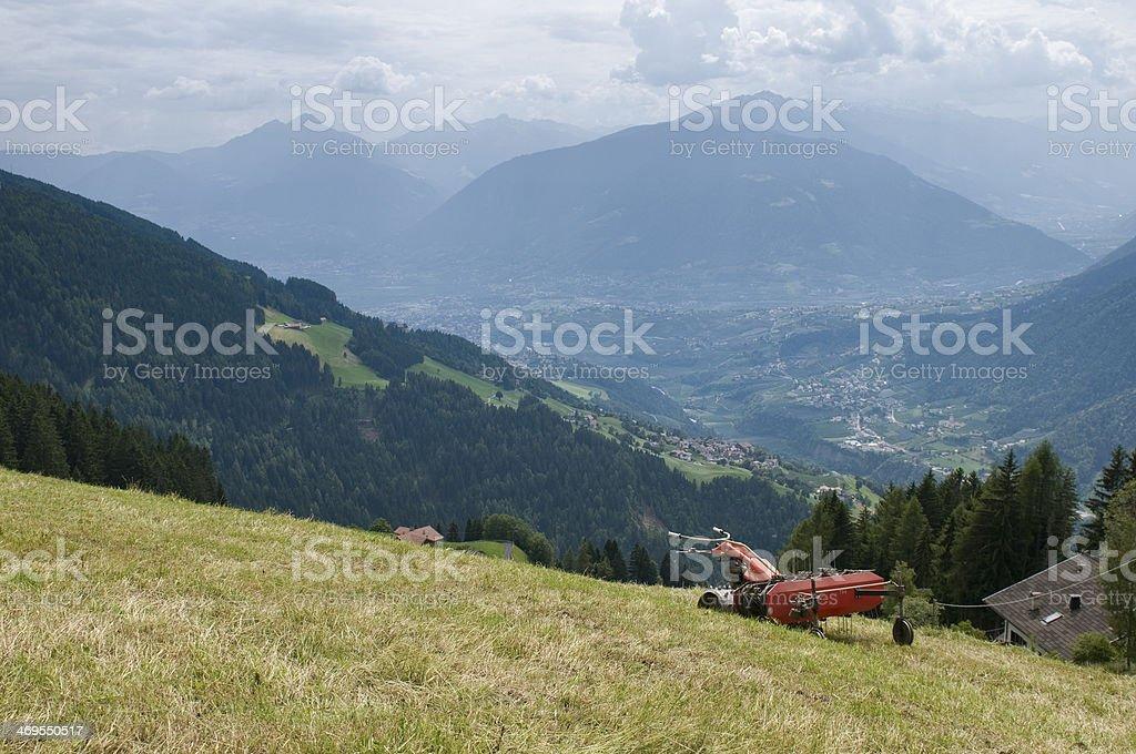 tedder on alpine pasture stock photo