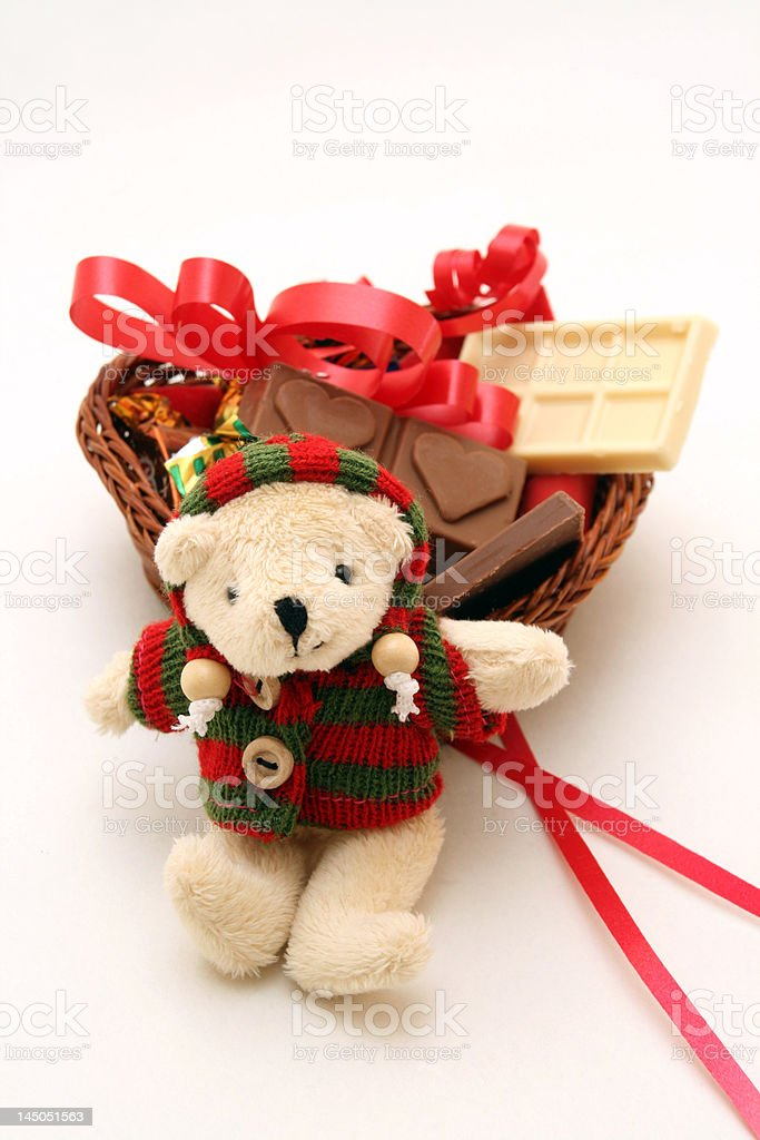 Teddy bear and basket of chocolates. royalty-free stock photo