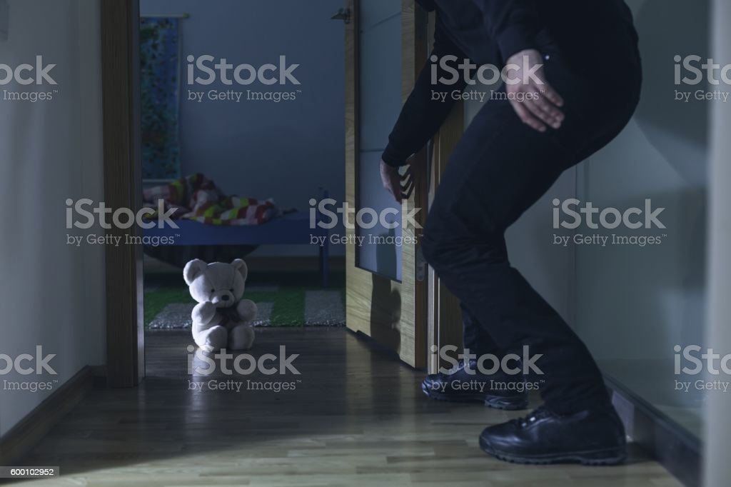 Teddy bear as a guardian can't do much stock photo