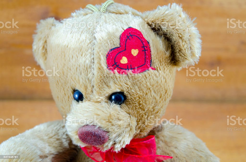 Teddy bear close up with a heart on his head royalty-free stock vector art