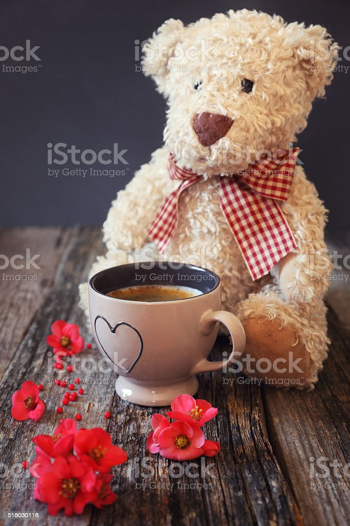 Teddy bear, flowers and coffee stock photo