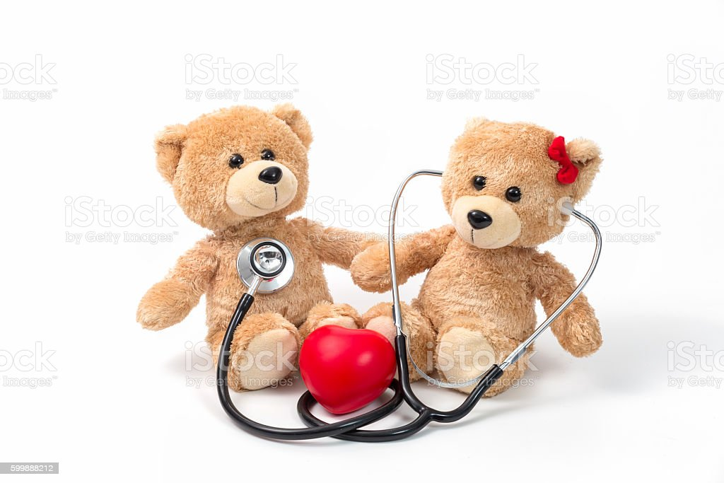 Teddy Bear: Health insurance or love concept on white background stock photo