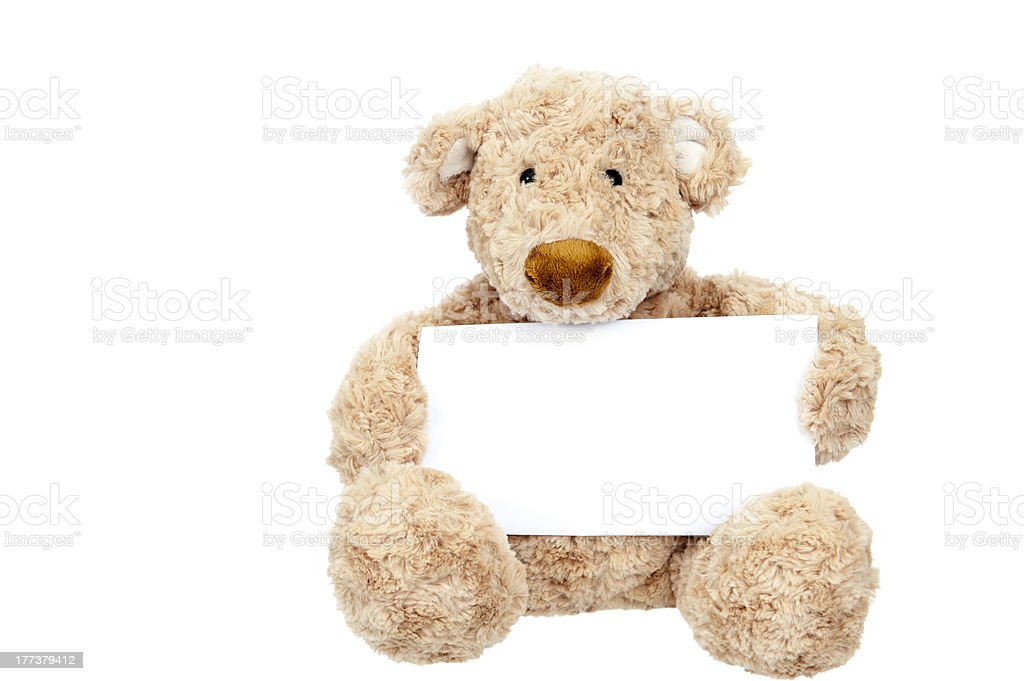Teddy bear holding an add space royalty-free stock photo