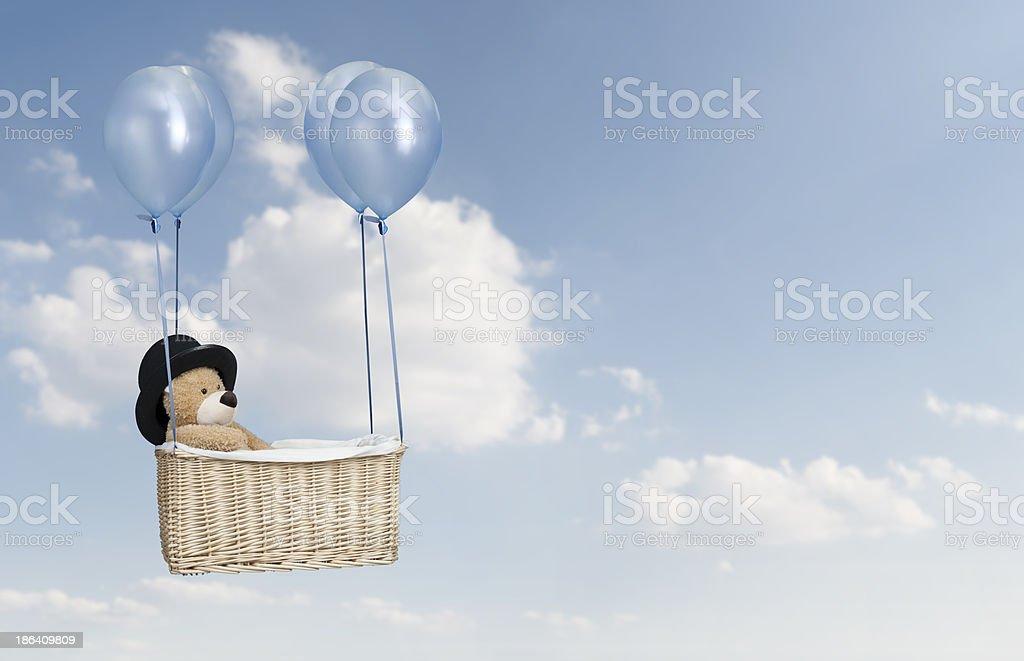 teddy bear in a hot air balloon stock photo